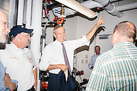 Former New York governor and Republican presidential candidate George Pataki speaks with members of the New Hampshire CleanTech Council at the Hopkinton NH Fire Station in Contoocook, Hopkinton, New Hampshire. The NH CleanTech Council advocates and represents New Hampshire clean technology and energy business sector.The fire station had recently installed a clean-burning wood pellet boiler of European design. Duing the meeting, Pataki said he hoped the next generations of these sorts of boilers and furnaces would be manufactured in the US.