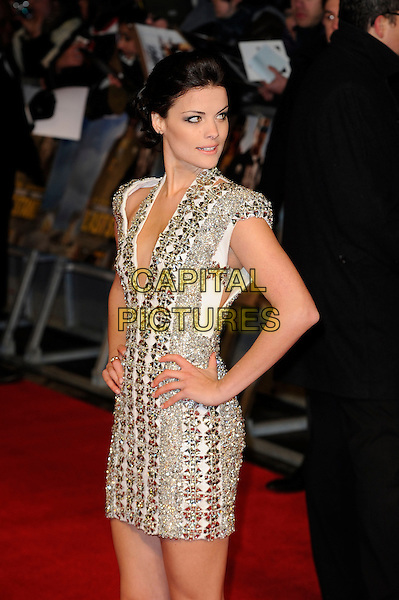 Jaimie Alexander.'The Last Stand' UK film premiere at Odeon West End cinema, Leicester Square, London, England..22nd January 2013.half length dress hands on hips cap looking over shoulder sleeves low cut neckline white silver halterneck embellished jewel encrusted .CAP/MAR.© Martin Harris/Capital Pictures.