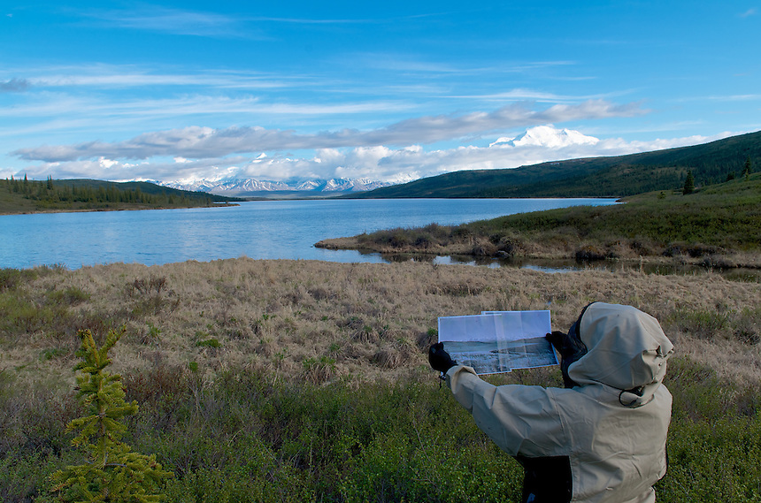 June 5, 2012 Lacy Karpilo holds a 1963 panoramic photo of Wonder Lake and Mount McKinley (also known as Denali) taken in the same location by Verde Watson in Denali National Park and Preserve, Alaska, United States.