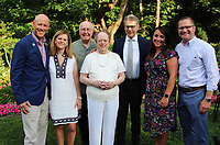 NWA Democrat-Gazette/CARIN SCHOPPMEYER Peter and Barb Lane (from left), Reed and Mary Ann Greenwood, MaestroCorrado Rovaris and Lindsey and Brock Gearhart gather at An Evening with the Maestro on June 28 at the Greenwood home in Fayetteville.