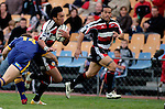 Koiatu Koiatu tries to break through the tackle of Ben Smith as Tevita Tuifua ranges up on the outside. Air NZ Cup game between Counties Manukau & Otago played at Mt Smart Stadium,Auckland on the 29th of July 2006. Otago won 23 - 19.