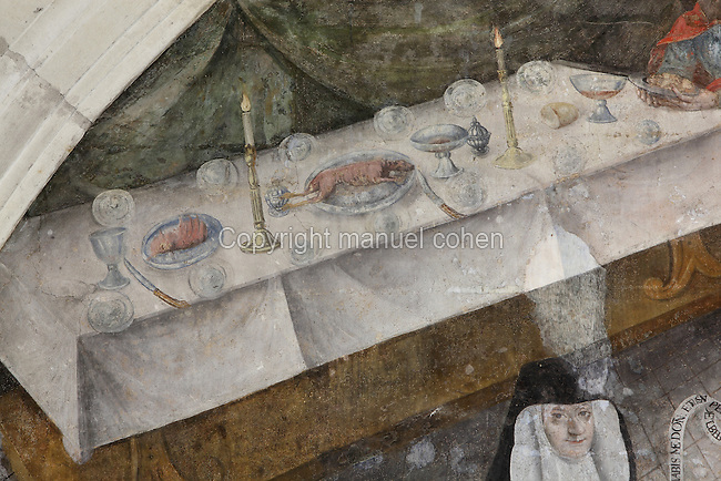 Detail of the Last Supper fresco showing the table laid and a lamb on a plate symbolising Christ's sacrifice and portrait of Eleonore de Bourbon, 29th Abbess of Fontevraud (1575-1611), Chapter House, Fontevraud Abbey, Fontevraud-l'Abbaye, Loire Valley, Maine-et-Loire, France. The Chapter House was built in the 16th century and its walls were painted in 1563 with frescoes of scenes from Christ's Passion by the Anjou artist Thomas Pot. The abbey itself was founded in 1100 by Robert of Arbrissel, who created the Order of Fontevraud. It was a double monastery for monks and nuns, run by an abbess. Picture by Manuel Cohen