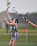 Belleville's Mackenzie Tavares passes the ball as a Lockport player attacks from behind. Belleville played Lockport in a quarterfinal game of the O'Fallon sectional at O'Fallon Sports Park on Monday May 20, 2019. <br /> Tim Vizer/Special to STLhighschoolsports.com