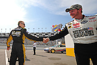 Jul. 4, 2008; Daytona Beach, FL, USA; NASCAR Sprint Cup Series driver Mark Martin (left) shakes hands with Dale Earnhardt Jr during qualifying for the Coke Zero 400 at Daytona International Speedway. Mandatory Credit: Mark J. Rebilas-