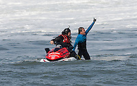 Carlos Burle celebrates after his run at the 2010 Mavericks Surf Contest in Half Moon Bay, California on February 13th, 2010.