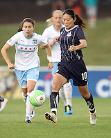 Homare Sawa #10 of the Washington Freedom kicks the ball away from Karen Carney #14 of the Chicago Red Stars during a WPS match at the Maryland Soccerplex, in Boyds Maryland on June 12 2010. The game ended in a 2-2 tie.
