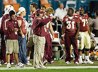Coach Bowden points out a formation on the field while conferring with his assistant coaches during the second quarter of the 2006 FedEx Orange Bowl Game.