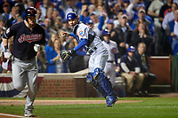 Chicago Cubs catcher Willson Contreras (40) throws to first base to complete the strike out of Jason Kipnis (left) in the first inning during Game 4 of the Major League Baseball World Series against the Cleveland Indians on October 29, 2016 at Wrigley Field in Chicago, Illinois.  (Mike Janes/Four Seam Images)