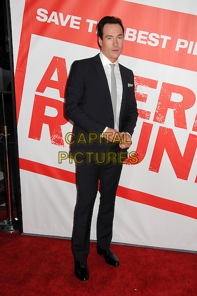 "Chris Klein.""American Reunion"" Los Angeles Premiere held at Grauman's Chinese Theatre, Hollywood, California, USA..19th March 2012.full length suit shirt black white tie grey gray.CAP/ADM/BP.©Byron Purvis/AdMedia/Capital Pictures."