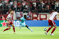 Davinson Sanchez of Tottenham Hotspur in action with Guilherme of Olympiacos Fc, during the UEFA Champions League match between Olympiacos Fc and Tottenham Hotspur, in Karaiskaki Stadium in Piraeus, Greece. Wednesday 18 September 2019