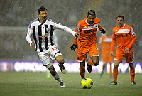 Pictured: Scott Sinclair of Swansea (R) challenged by Paul Scharner  (L) of West Bromwich. Saturday, 04 February 2012<br />