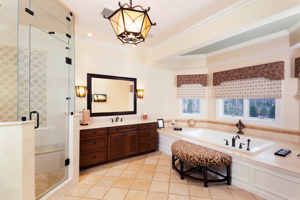 This master bath adds to the homeowner's experience by creating privacy through automated shades, a quiet mood via lighting control system