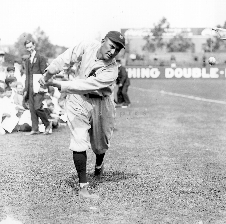 Ty Cobb of the Detroit Tigers practicing his swing before a game