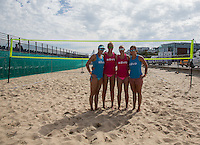 England (Blue) and Holland prepare for the match during the Women's England v Holland Volleyball match at Sandbanks, Poole, England on 10 July 2015. Photo by Andy Rowland.