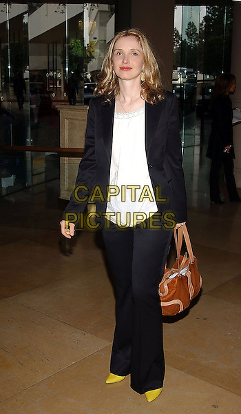 JULIE DELPY.77th Annual Academy Award Nominees Luncheon held at the Beverly Hilton Hotel. Beverly Hills, California .February 7th, 2005.Photo Credit: Jacqui Wong/AdMedia.full length yellow shoes black trousers cardigan brown leather bag.www.capitalpictures.com.sales@capitalpictures.com.© Capital Pictures.