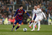 1st March 2020; Estadio Santiago Bernabeu, Madrid, Spain; La Liga Football, Real Madrid versus Club de Futbol Barcelona; Lionel Messi (FC Barcelona) turns away from the challenge of Sergio Ramos of Madrid