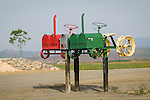 Home made colorful tractor mailboxes along the highway in Coalinga, Calif...(Red-Farmall; green-John Deere)