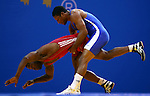 GUADALAJARA, MEXICO - OCTOBER 21:  Hansel Mercedes Martinez of Dominican Republic lifts Sixto Barrera of Peru off the matt in the in the Men's Greco-Roman 74kg Semifinal Bout during Day Six of the XVI Pan American Games at the Code II Sports Complex on October 21, 2011 in Guadalajara, Mexico.  (Photo by Donald Miralle for Mexsport) *** Local Caption ***
