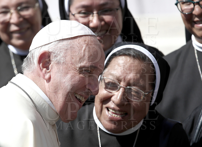 Papa Francesco saluta alcune suore al termine dell'udienza generale del mercoledi' in Piazza San Pietro, Citta' del Vaticano, 12 settembre 2018.<br /> Pope Francis greets nuns at the end of his weekly general audience in St. Peter's Square at the Vatican, on September 12, 2018.<br /> UPDATE IMAGES PRESS/Isabella Bonotto<br /> <br /> STRICTLY ONLY FOR EDITORIAL USE