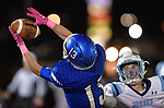 Columbia wide receiver Josh Marion (left) pulls in a pass as Jerseyville's John Collins watches. Jerseyville played at Columbia on Friday October 19, 2018.<br /> Tim Vizer/Special to STLhighschoolsports.com