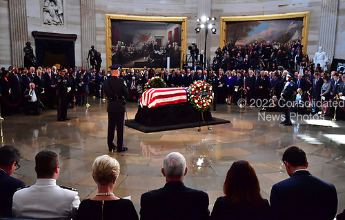 Vice President Mike Pence (C) sits with City McCain, the widow of Sen. John McCain, R-Ariz., during his memorial service in the Capitol Rotunda where he will lie in state at the U.S. Capitol, in Washington, DC on Friday, August 31, 2018. McCain, an Arizona Republican, presidential candidate, and war hero, died August 25th at the age of 81. He is the 31st person to lie in state at the Capitol in 166 years. Photo Ken Cedeno/UPI