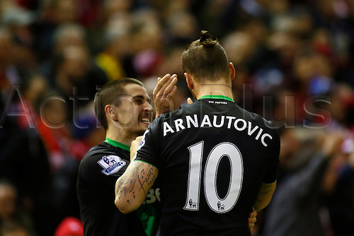 26.01.2016. Anfield, Liverpool, England. Capital One Cup Semi Final 2nd Leg. Liverpool versus Stoke. Stoke striker Marko Arnautovic celebrates with Bojan Krkić after scoring his team's first goal.