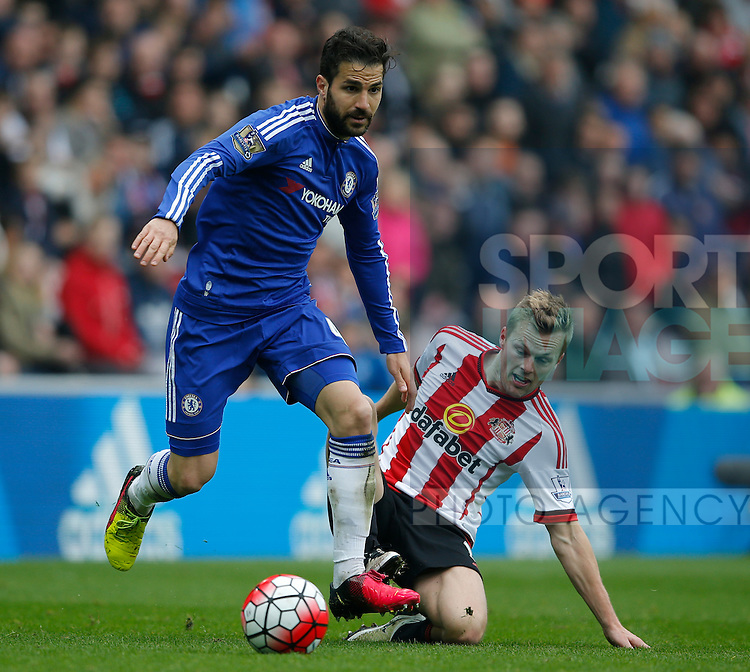 Cesc Fabregas of Chelsea tackled by Duncan Watmore of Sunderland during the Barclays Premier League match at the Stadium of Light, Sunderland. Photo credit should read: Simon Bellis/Sportimage