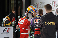 MELBOURNE, 17 MARCH - The top 3 drivers remove their helmets and prepare for podium formalities in the 2013 Formula One Rolex Australian Grand Prix at the Albert Park Circuit in Melbourne, Australia. Photo Sydney Low/syd-low.com