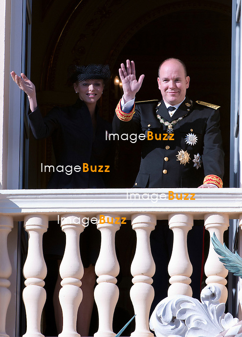 "MONACO - NOVEMBER 19: Princess Charlene of Monaco and Prince Albert II of Monaco attend the National Day Parade from the balcony of Monaco Palace as part of Monaco National Day Celebrations at Monaco Palace on November 19, 2012 in Monaco.Armerican Navy sailors from the ""Mount Whitney"" war boat parade for the Monaco National Day."