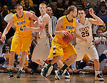 SIOUX FALLS, SD - MARCH 12:  Taylor Braun #24 of North Dakota State drives toward Chad White #25 of South Dakota State during their championship game at the 2013 Summit League Tournament at the Sioux Falls Arena. In the background are Marshall Bjorklund #42 of the NDSU and Tony Fiegen of SDSU. (Photo by Dick Carlson/Inertia)