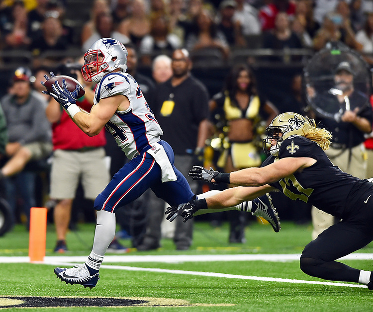 (New Orleans, LA, 09/17/17) New England Patriots running back Rex Burkhead, left, catches a touchdown pass in front of New Orleans Saints linebacker Alex Anzalone during the first half of an NFL football game at the Superdome in New Orleans, Louisiana on Sunday, September 17, 2017. Photo by Christopher Evans