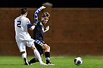 GREENSBORO, NC - DECEMBER 02: Erlend Kemker #20 of North Park University battles Danny Brandt #2 of Messiah College for the ball during the Division III Men's Soccer Championship held at UNC Greensboro Soccer Stadium on December 2, 2017 in Greensboro, North Carolina. Messiah College defeated North Park University 2-1 to win the national title. (Photo by Grant Halverson/NCAA Photos via Getty Images)