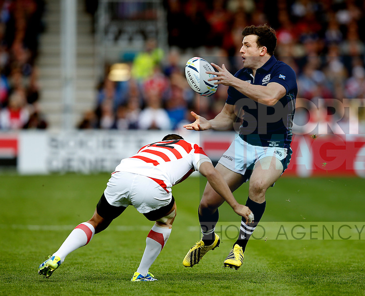 Matt Scott of Scotland release the ball as he is tackled by Yu Tamura of Japan - Rugby World Cup 2015 - Pool B - Scotland vs Japan - Kingsholm Stadium - Gloucester - England - 23rd September 2015 - Picture Simon Bellis/Sportimage