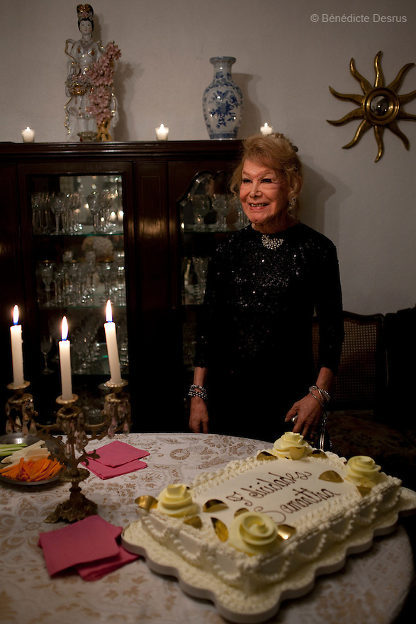 """July 7, 2012 – Mexico, Mexico City - Samantha celebrates her80th birthday with close friends in Mexico City.Samantha Flores is an 80-year-old transgender woman from Veracruz, Mexico. She is a prominent social activist for LGBTQI rights and is the founder of the non-profit organization """"Laetus Vitae"""", a day shelter for elderly gay people in Mexico City. Senior citizens in general are many times prone to neglect and abandonment by their families, leaving them all but invisible. Their plight can be even worse if they are homosexual. Photo credit: Bénédicte Desrus"""