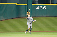 Rice Owls center fielder John Williamson #8 settles under a fly ball during the game against the Texas Tech Red Raiders at Minute Maid Park on March 2, 2014 in Houston, Texas.  The Red Raiders defeated the Owls 3-2 to finish the tournament 2-1.  (Brian Westerholt/Four Seam Images)