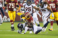 Landover, MD - August 24, 2018: Washington Redskins running back Adrian Peterson (26) gets tackled during the preseason game between Denver Broncos and Washington Redskins at FedEx Field in Landover, MD.   (Photo by Elliott Brown/Media Images International)