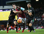 West Ham's Michail Antonio tussles with Stoke's Marco Van Ginkel and Erik Pieters<br /> <br /> Barclays Premier League - West Ham United v Stoke City - Upton Park - England -12th December 2015 - Picture David Klein/Sportimage