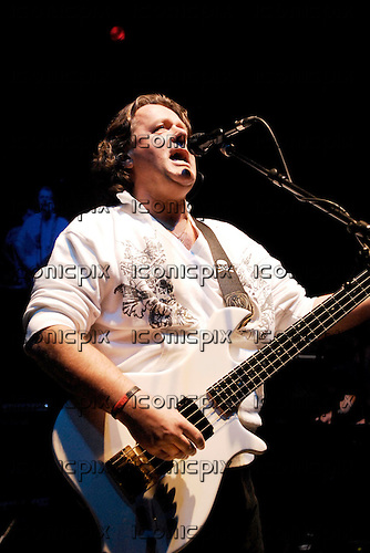 Asia - vocalist and bassist John Wetton - the four original members reunite for the 25th anniversary - performing live at the Shepherds Bush Empire, London UK - 03 Dec 2006.  Photo credit: George Chin/IconicPix