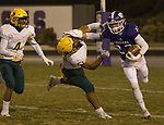 Spanish Springs Parker running back Luthy (23) straight-arms  Manogue's Kruz Conway (51) on Friday night, November 9, 2018 at Spanish Springs High School in Sparks, Nevada.