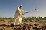 A man prepares his small plot of land for planting at the edge of the Habile Camp for internally displaced persons outside the village of Koukou Angarana, Chad. Some 28,000 people live in precarious conditions in this camp. More than 180,000 residents of eastern Chad have been displaced by violence spilling over from neighboring Darfur, inter-ethnic conflict, and fighting between rebels and the Chadian government.