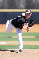 Wake Forest Demon Deacons relief pitcher Connor Kaden (40) follows through on his delivery against the Youngstown State Penguins at Wake Forest Baseball Park on February 24, 2013 in Winston-Salem, North Carolina.  The Demon Deacons defeated the Penguins 6-5.  (Brian Westerholt/Four Seam Images)