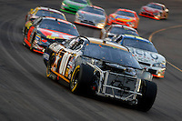 Apr 22, 2006; Phoenix, AZ, USA; The damaged car of Nascar Nextel Cup driver Joe Nemechek  of the (01) U.S. Army Chevrolet Monte Carlo leads a pack of cars during the Subway Fresh 500 at Phoenix International Raceway. Mandatory Credit: Mark J. Rebilas-US PRESSWIRE Copyright © 2006 Mark J. Rebilas..