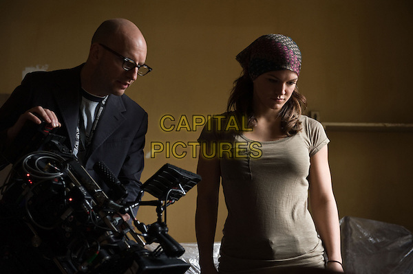 Director Steven Soderbergh and Gina Carano.on the set of Haywire.*Filmstill - Editorial Use Only*.CAP/FB.Supplied by Capital Pictures.