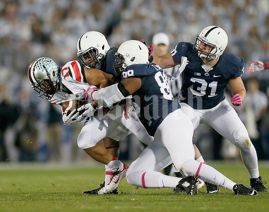 The Penn State defense brings down Ohio State Buckeyes running back Jalin Marshall (17) at Beaver Stadium on October 25, 2014.  (Chris Russell/Dispatch Photo)