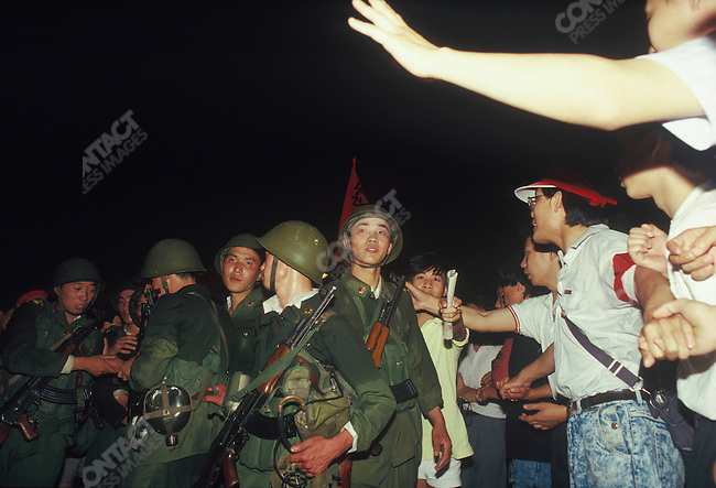 Unarmed protesters suround soldiers, Qianmen area near Tiananmen Square, Beijing, China, June 1989