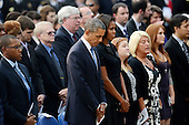 United States President Barack Obama and first lady Michelle Obama observe a moment of silence at a memorial for the victims of the Washington Navy Yard shooting at the Marine Barracks, September 22, 2013 in Washington, D.C.  The President and First Lady also visited with families of the victims.<br /> Credit: Olivier Douliery / Pool via CNP