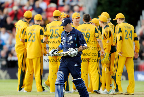 Scotland V Australia ODI at Grange CC, Edinburgh - Scotland capt Gavin Hamilton departs on 38, with Australia celebrating - Picture by Donald MacLeod 28.08.09