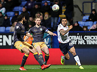 Bolton Wanderers' Josh Magennis competing with Sheffield Wednesday's Tom Lees and Michael Hector<br /> <br /> Photographer Andrew Kearns/CameraSport<br /> <br /> The EFL Sky Bet Championship - Bolton Wanderers v Sheffield Wednesday - Tuesday 12th March 2019 - University of Bolton Stadium - Bolton<br /> <br /> World Copyright © 2019 CameraSport. All rights reserved. 43 Linden Ave. Countesthorpe. Leicester. England. LE8 5PG - Tel: +44 (0) 116 277 4147 - admin@camerasport.com - www.camerasport.com