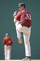 Starting pitcher Chris Flexen (31) of the Savannah Sand Gnats delivers a pitch in a game against the Greenville Drive on Sunday, June 22, 2014, at Fluor Field at the West End in Greenville, South Carolina. Greenville won, 7-3. (Tom Priddy/Four Seam Images)