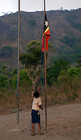 A young boy raises the Timorese national flag in the mountain town of Laclubar, Timor-Leste on Wednesday, Oct. 19th, 2011.  Photographer: Daniel J. Groshong/The Hummingfish Foundation